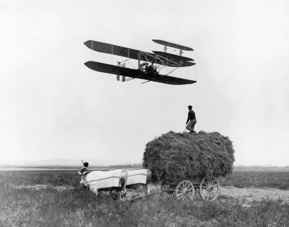 Wright flyer over hay wagon.jpg