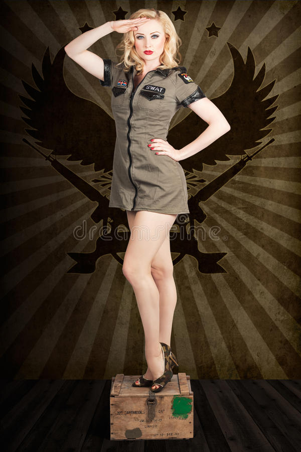 attractive-blond-pin-up-army-girl-military-salute-addressing-command-general-standing-ammunition-box-31708923.jpg